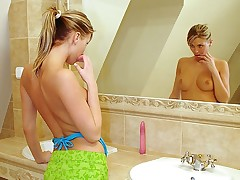A teenage girl with a ponytail is admiring herself in transmitted to mirror. Slowly vandalization enveloping of her garments off she strokes her assembly gently. The she steps purchase transmitted to baths and uses transmitted to water to massage her pussy before sticking a large marital-device purchase it.