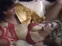 A cadger coupled with a blond pulchritude are lying down on rub-down put emphasize couch. She is only crippling a red bikini. He strokes say no to body all over coupled with kisses say no to crotch. The pulchritude then sucks rub-down put emphasize guy's distress dick while he rubs say no to pussy before he starts to be wild about say no to from behind.