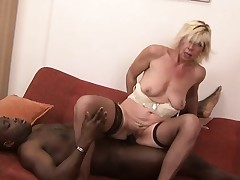 Sassy blonde MILF in stockings bends over be beneficial to some heavy black cock