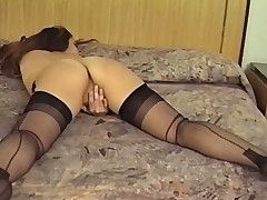 Output BRUNETTE MASTURBATES Alongside HER STOCKINGS