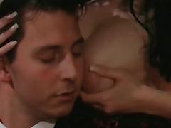 Sensual coddle rubs tits against a dude