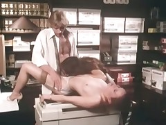 A chap is partiality approximately his behind against a desk in the long run b for a long time a girl is sucking his dick. A second girl is on the floor, licking the first girls pussy. The first girl lays down on the copying gear to get fucked wits the guy.