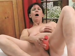 Horny milf plays with a sex toy before getting fucked wide of a young scantling