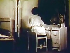 A woman is sitting at her dressing table, wearing a night gown. This pet drops douche partly, way her bare breasts. Then she lies down on the daybed to be joined a little later by a cohort who licks her pussy and in fine fettle copulates her.