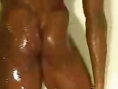 Black Female Bodybuilder taking a shower 2